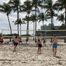 4 players beach volleyball.MOV