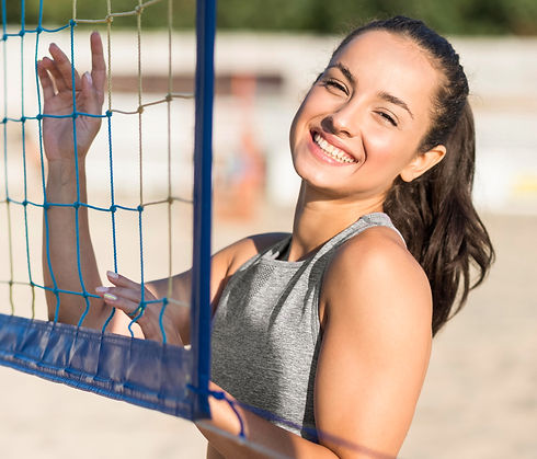 smiley-female-volleyball-player-beach-po