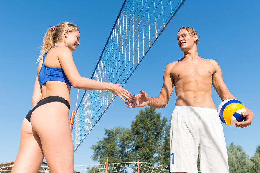 low-angle-of-male-and-female-volleyball-