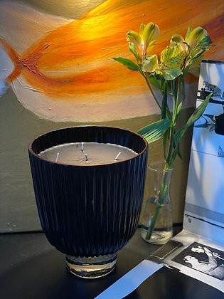 Luxurious  large scented candle in a big black blown glass.