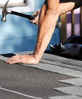 Local Templeton handyman fixing a roof shingle