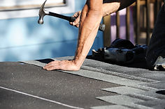 repairing a flat roof for hail damage
