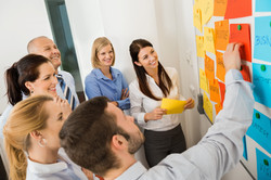 Group at whiteboard19351476