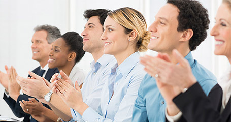 People clapping with smiles