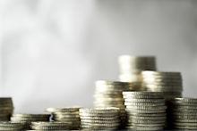 Varias monedas, apiladas una encima de otra. Representa lo poco que cuesta nuestro servicio. Es barato, asequible.
