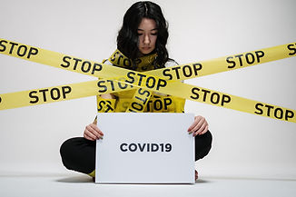 woman-holding-covid-sign-3951616.jpg