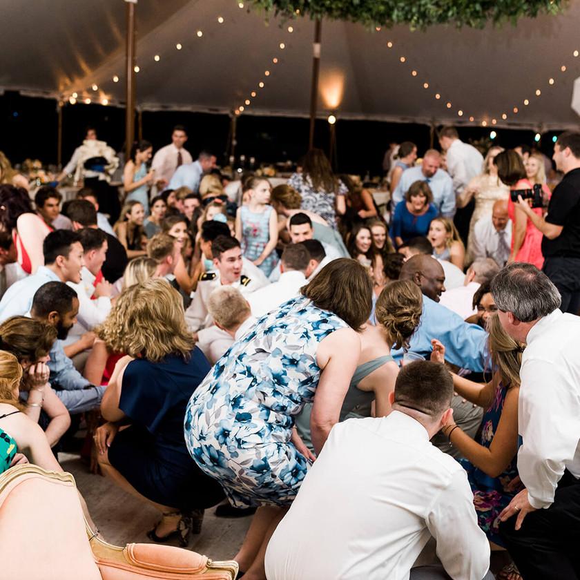 wedding guests get low on dance floor