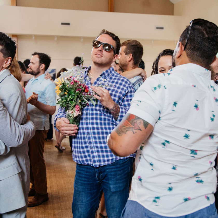 guy holding bouquet while dancing