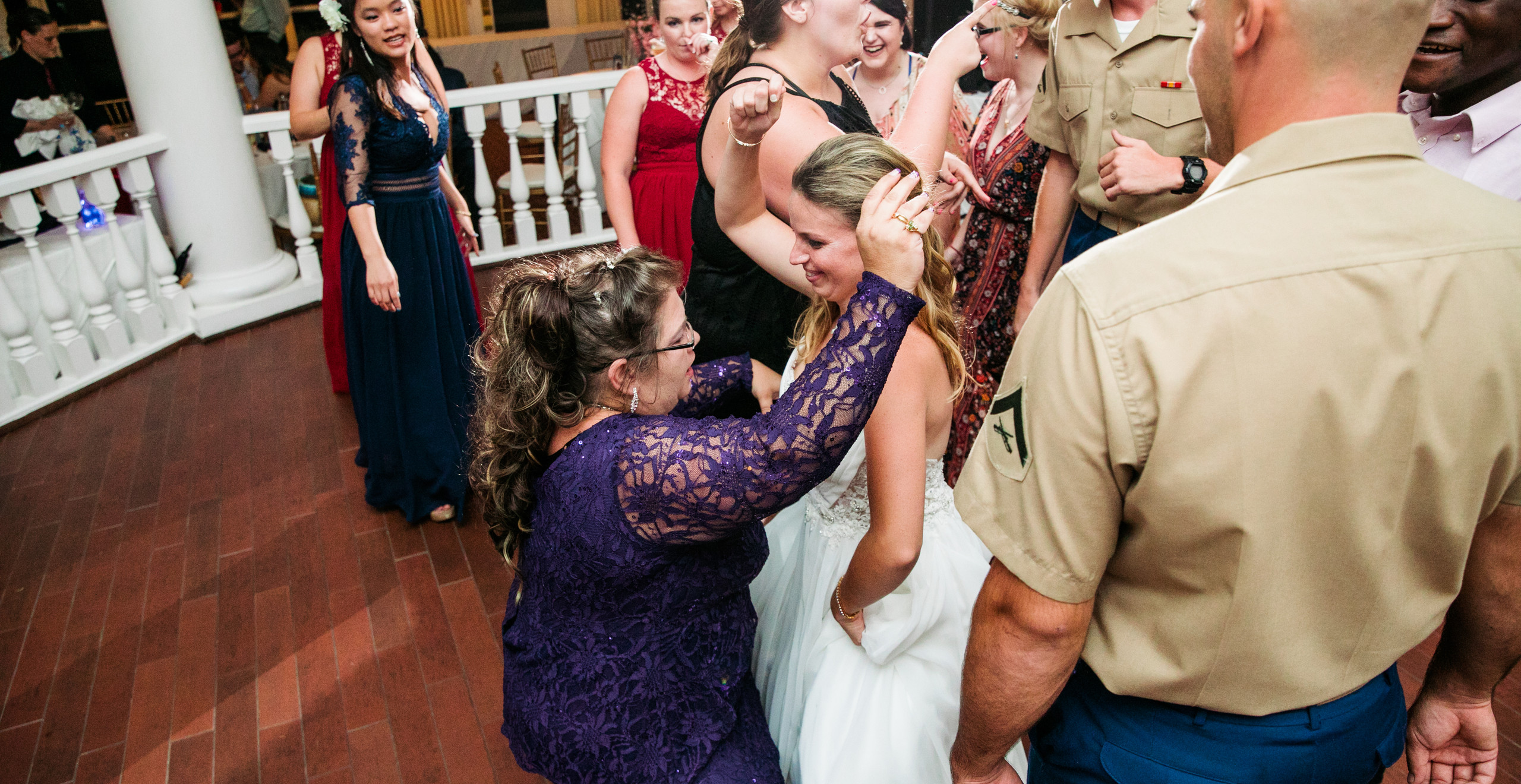 bride dancing with mom