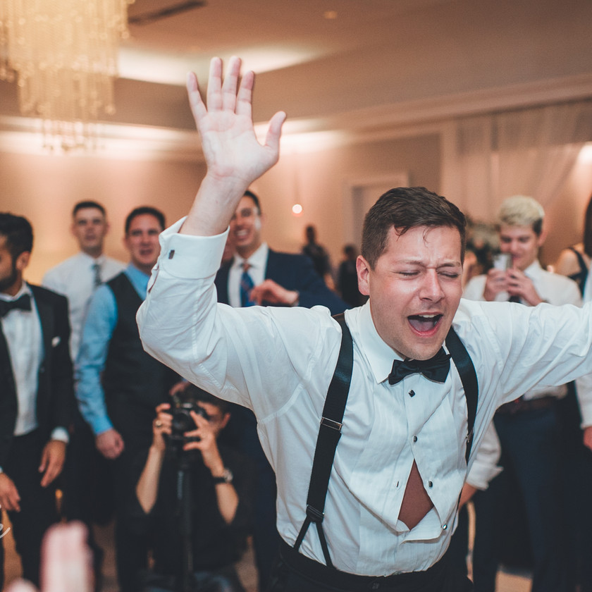 guy in tux dancing with beer in hand