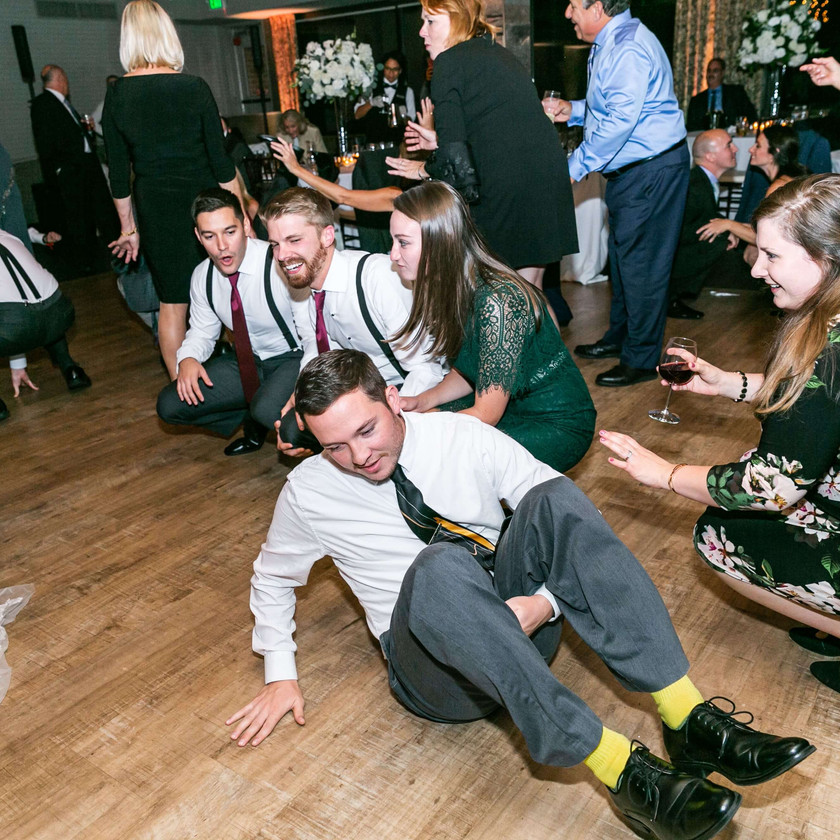 guests squat and sit on the dance floor