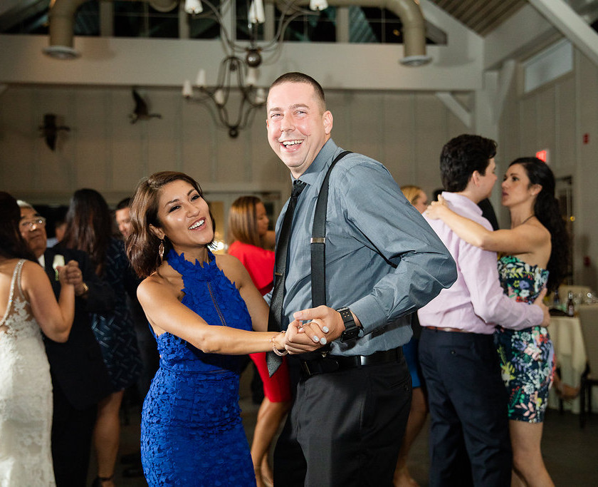 tall man and woman in blue dress dance