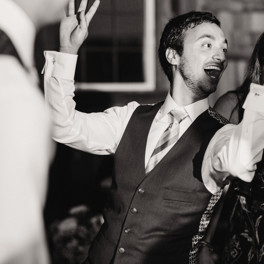groomsman dancing with hands out