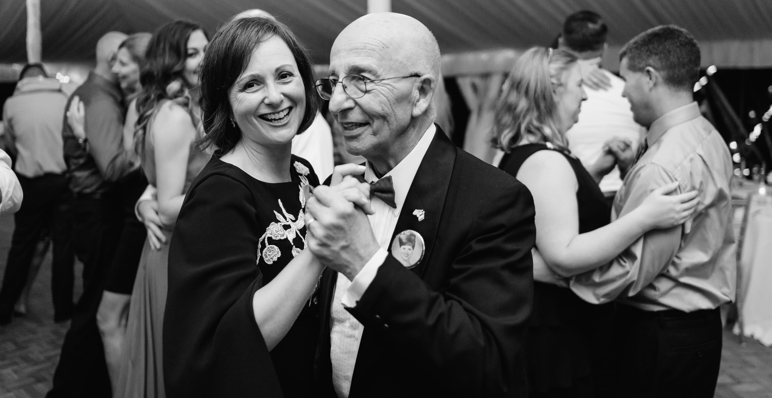 grandfather slow dancing at wedding