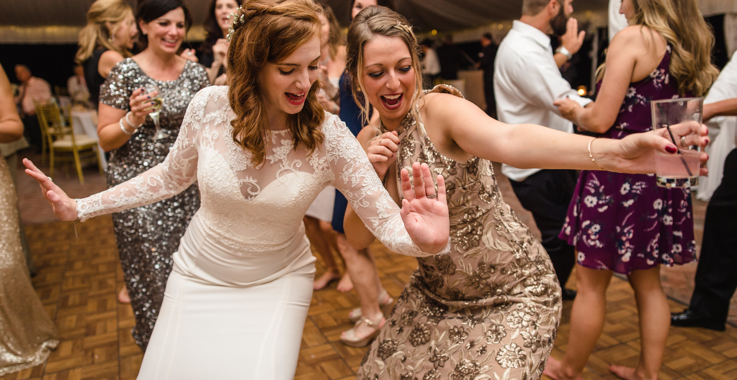bride dancing with friend at wedding