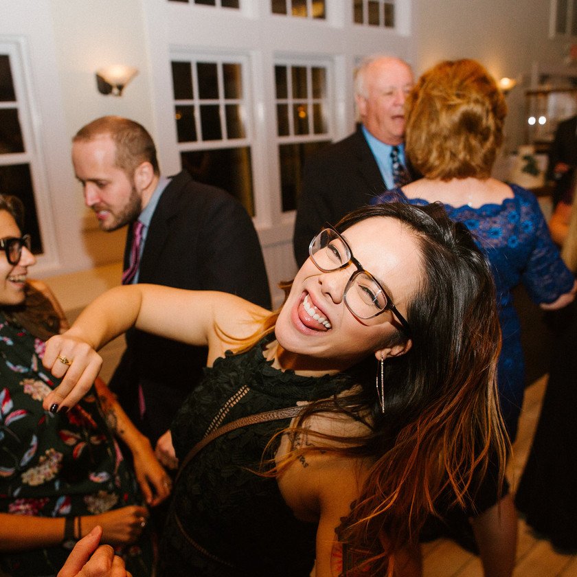woman with glasses dancing