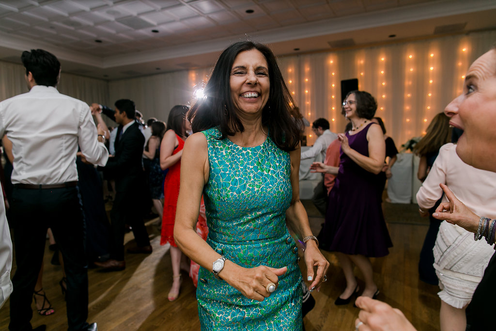 woman in green dress dancing at wedding