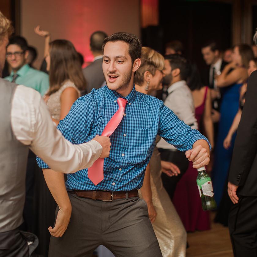 Four Seasons Baltimore wedding reception guy in blue shirt dancing