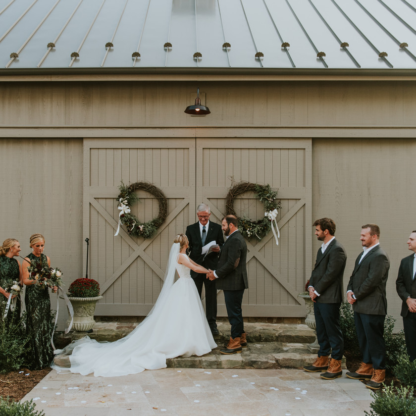 wedding ceremony in front of barn