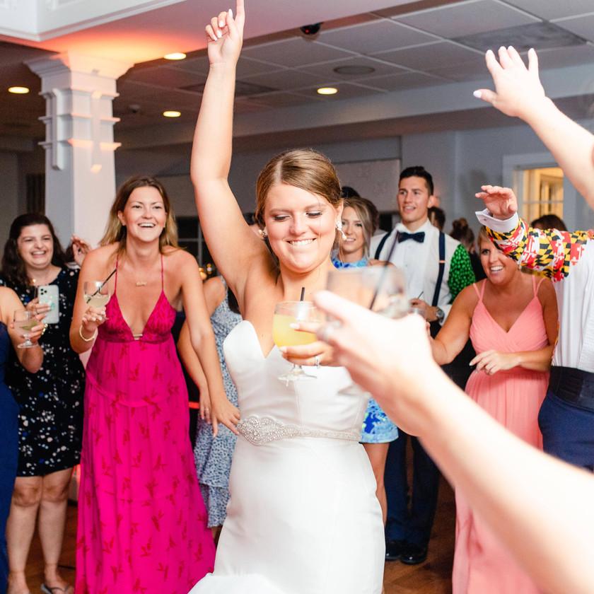 bride dancing while women watch