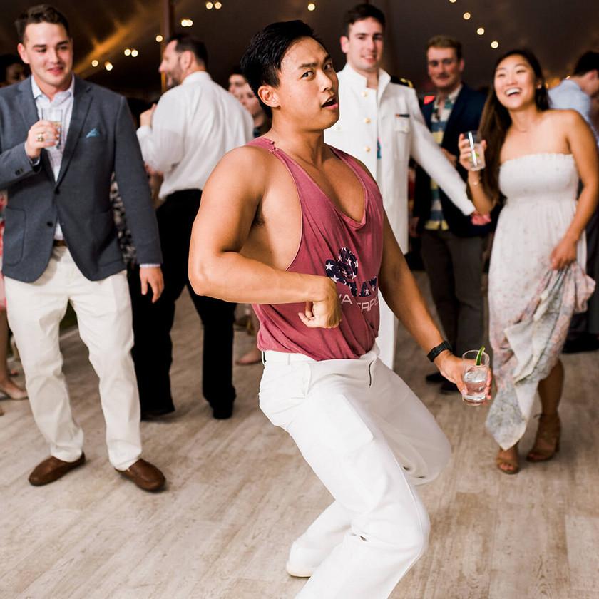 guy in tank top dancing at wedding