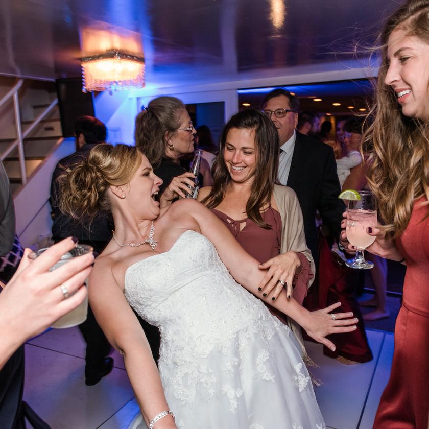 bride and women dancing