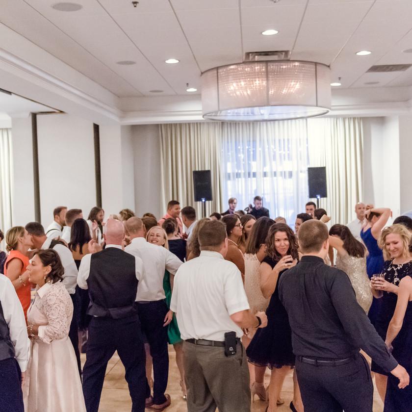wedding guests dance in ballroom