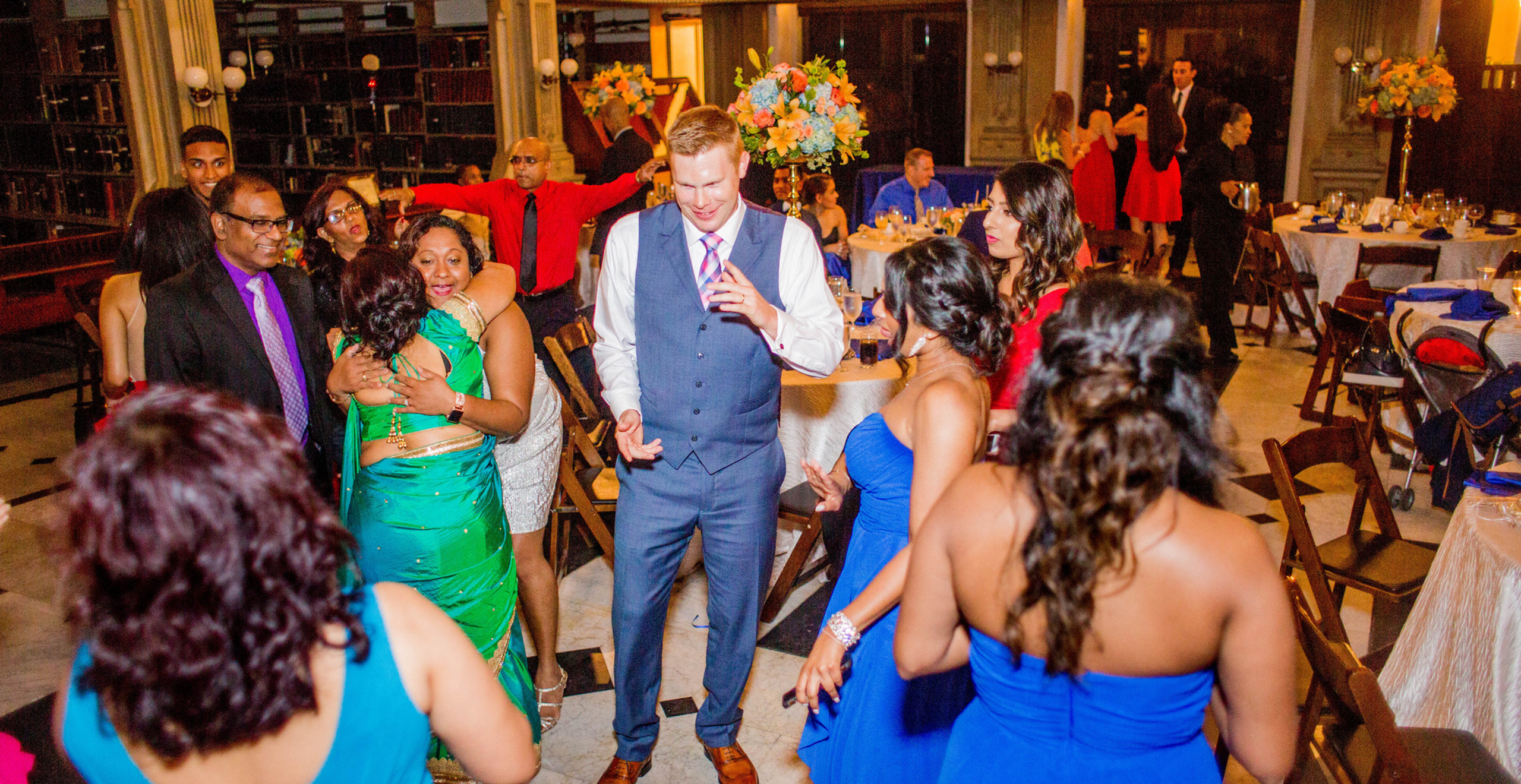 groom dancing with family