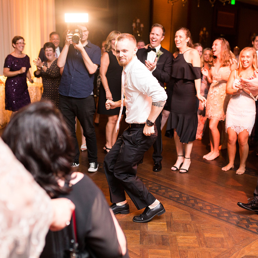 guy dancing in center of dance floor at wedding