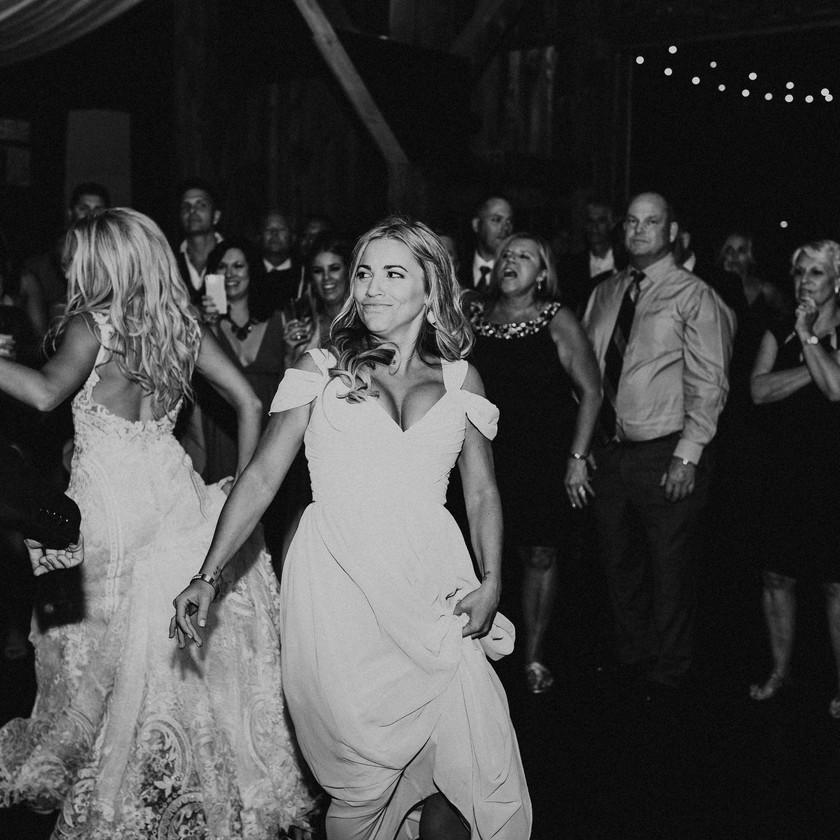 bridesmaid dancing at wedding
