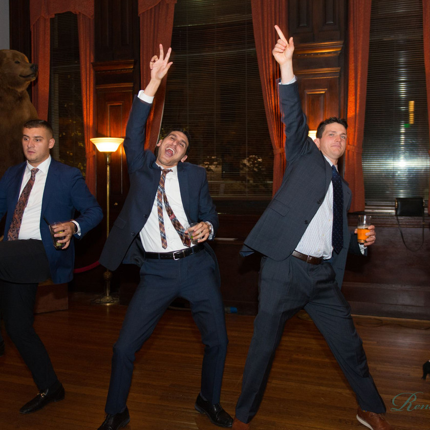 three guys dance at wedding