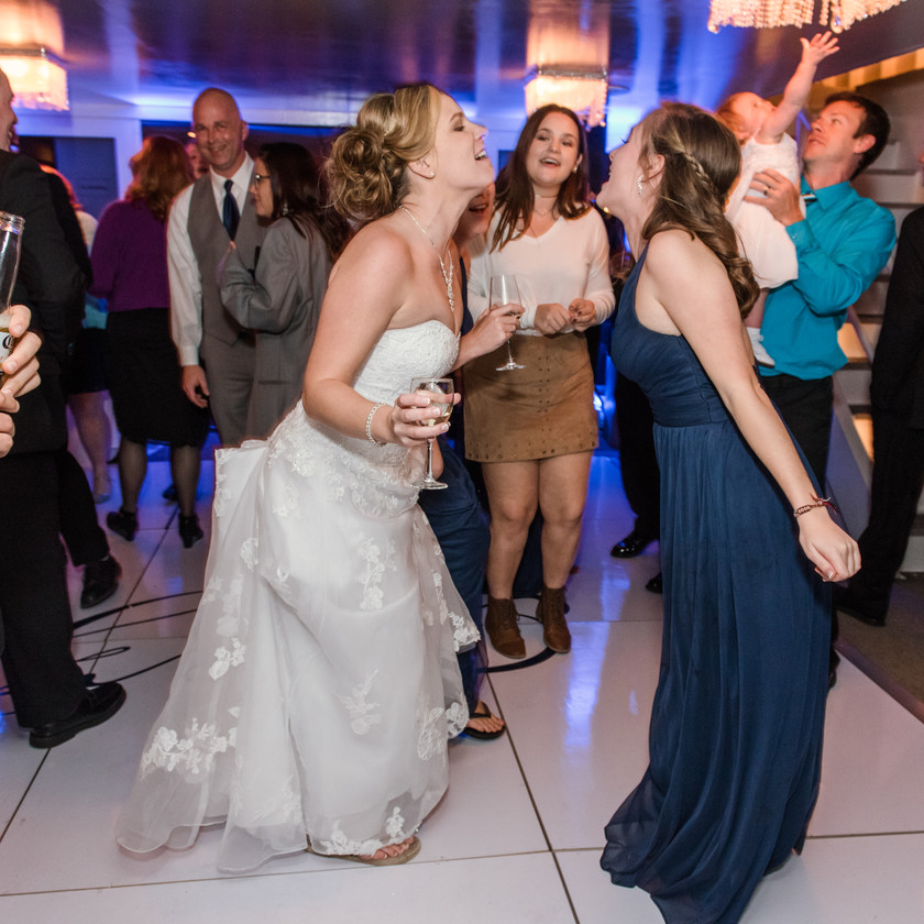 bride and guests singing and dancing