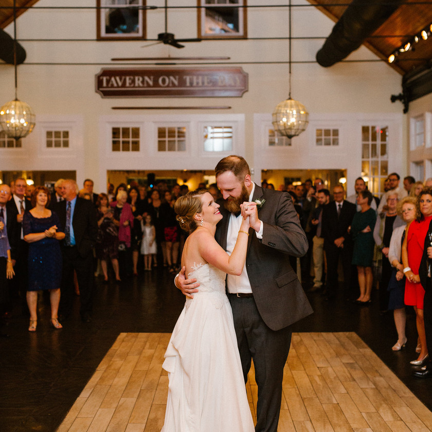 bride and groom first dance surrounded by friends