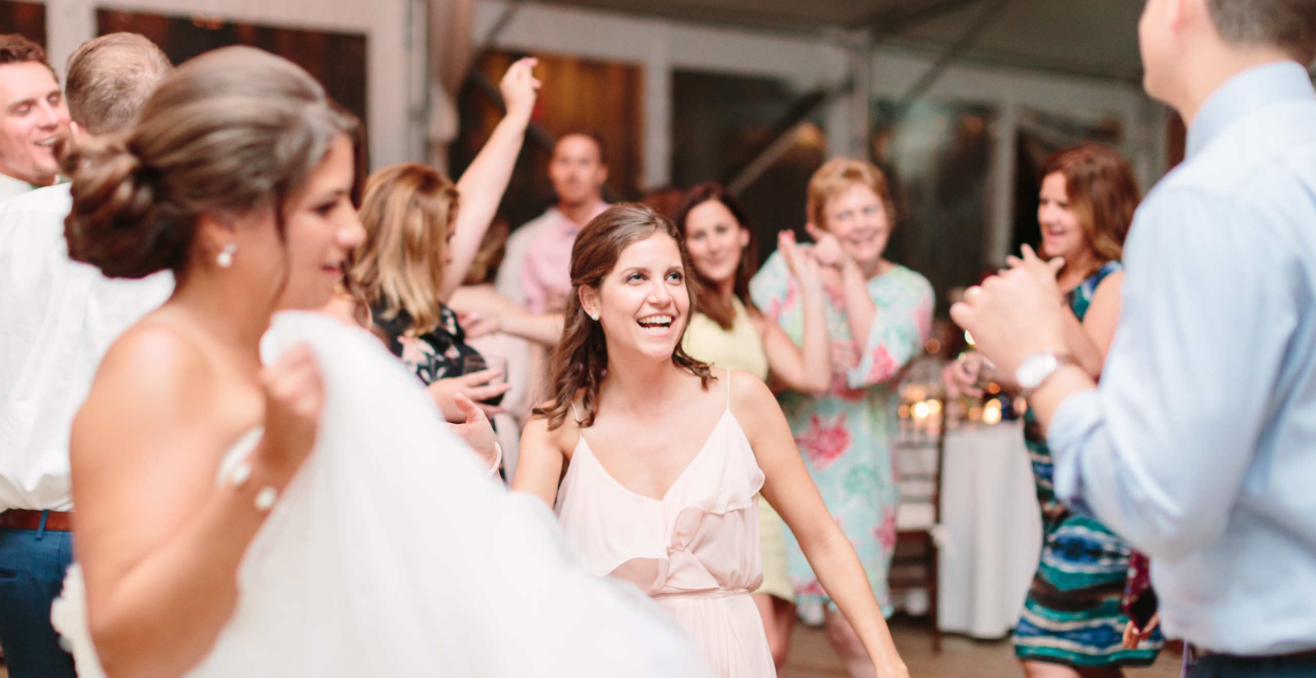 bridesmaid dancing and smiling