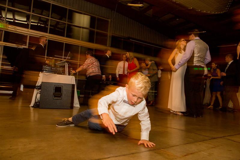 boy spins on floor at wedding