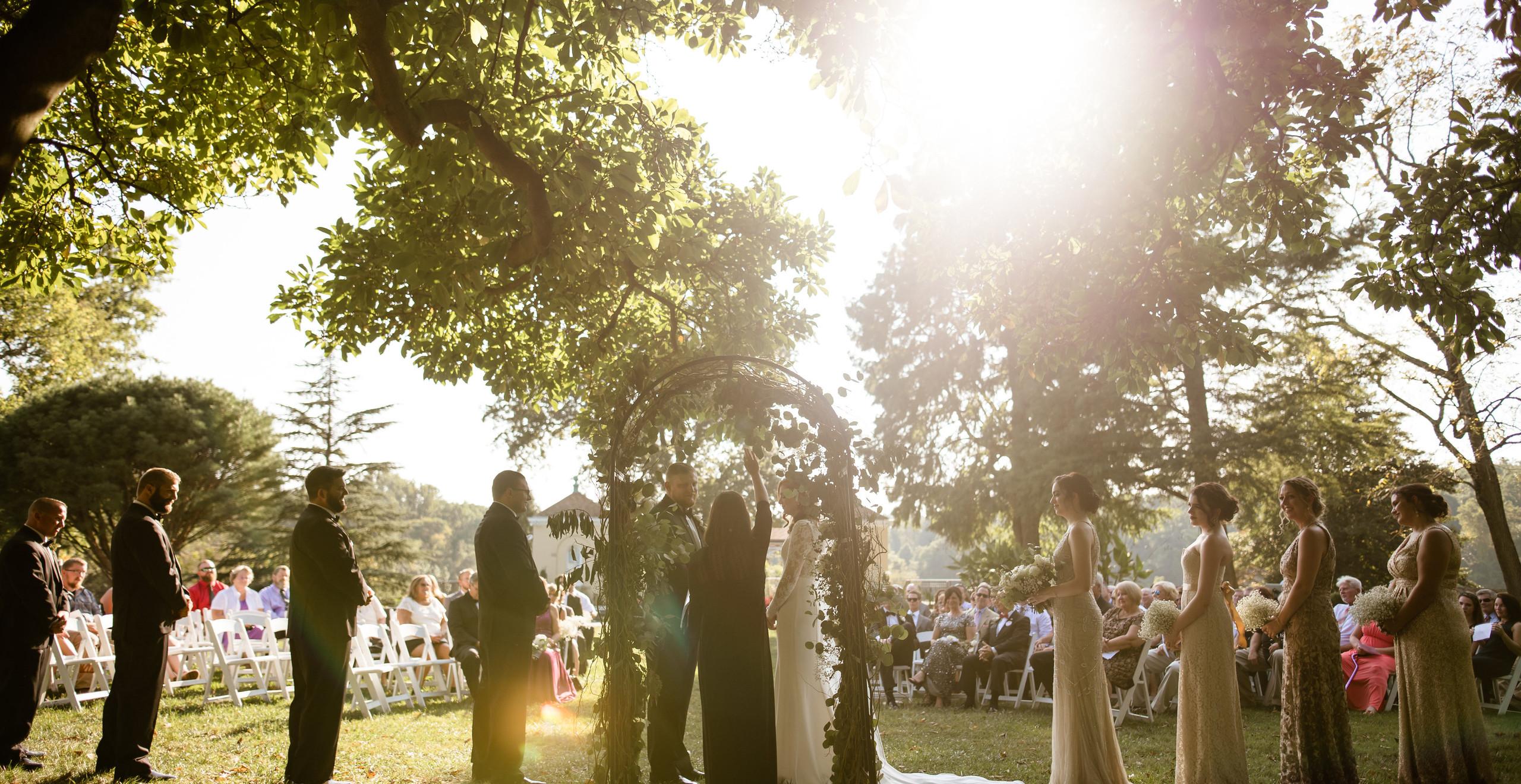 wedding ceremony underneath tree