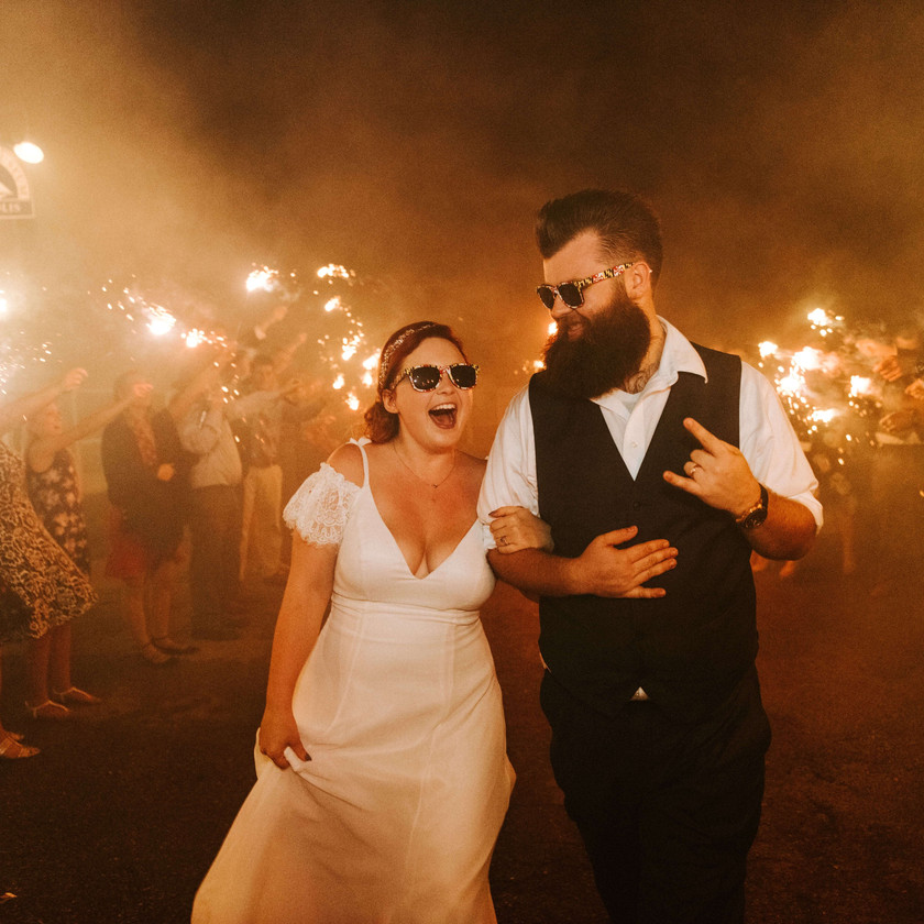 bride and groom exit to sparklers