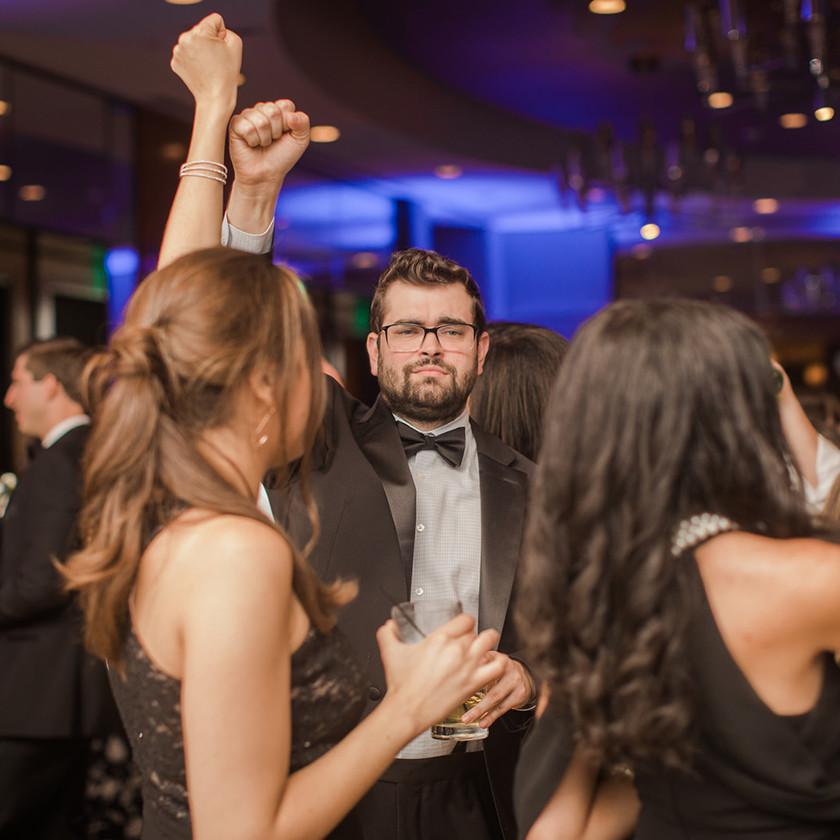 Four Seasons Baltimore wedding reception guy in tux dancing