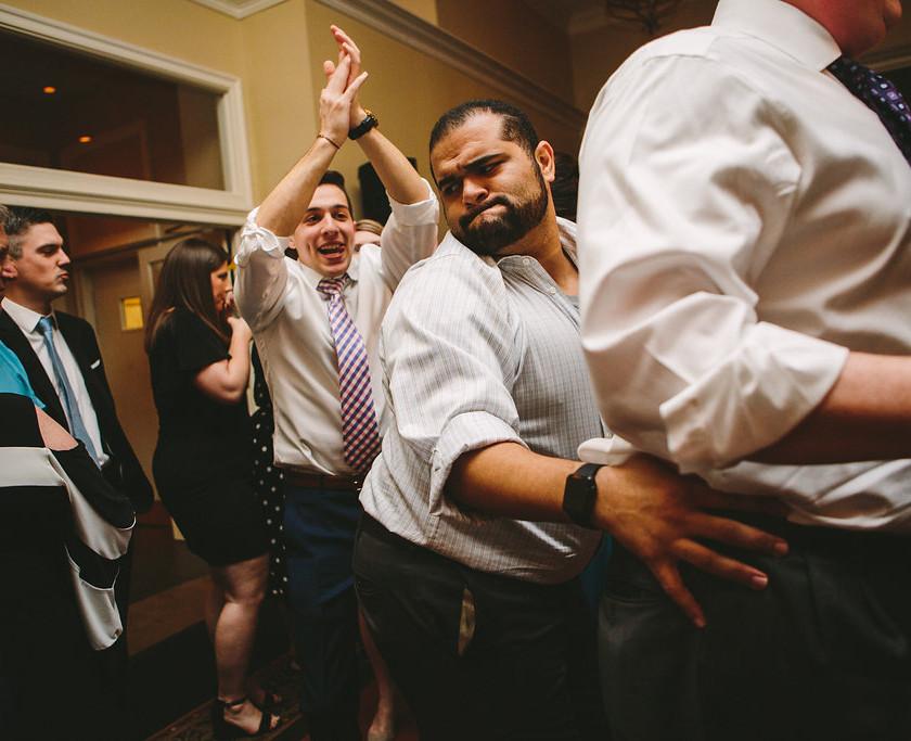 guys do the train on the dance floor at wedding