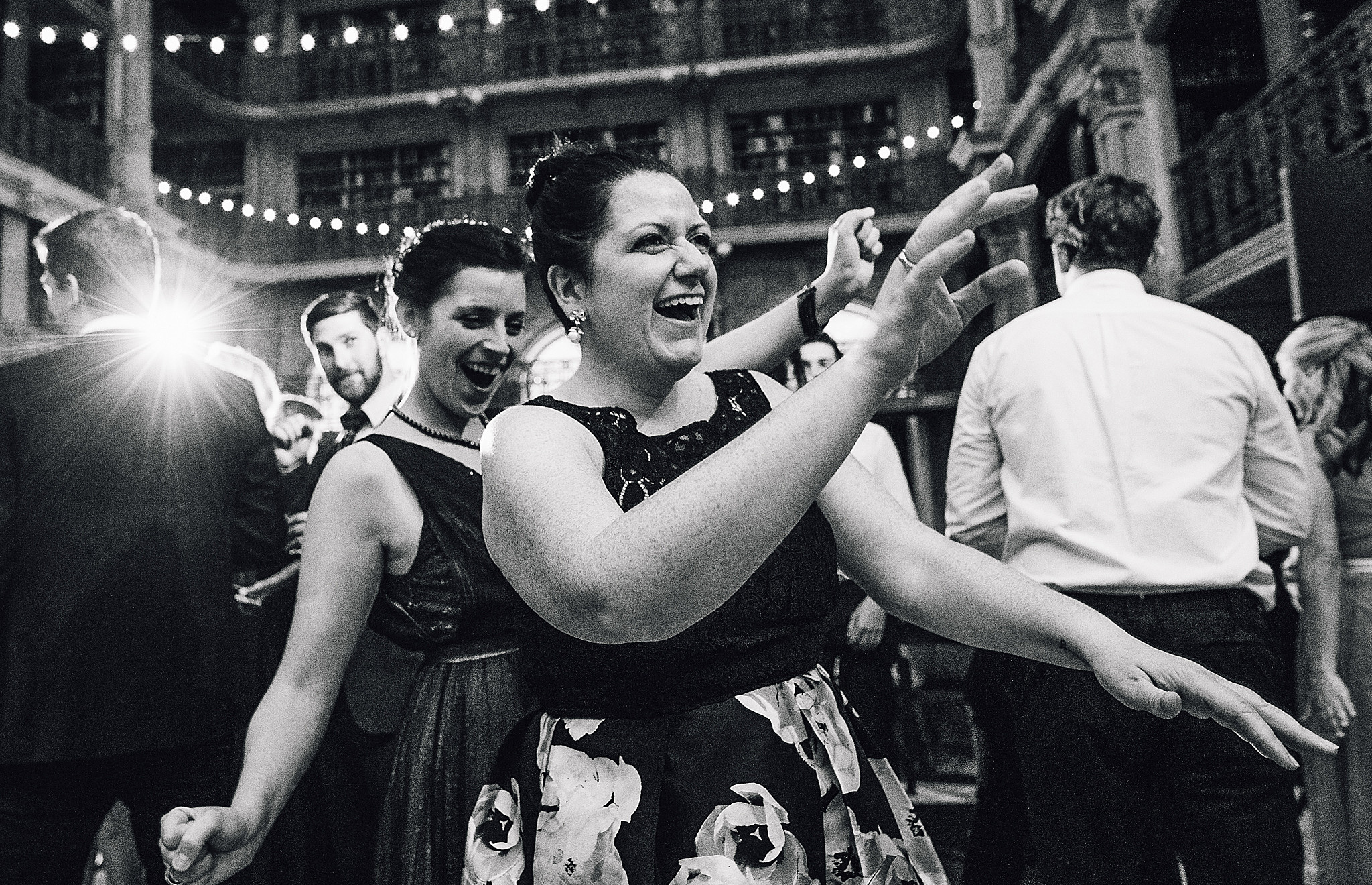 women dance with each other at wedding