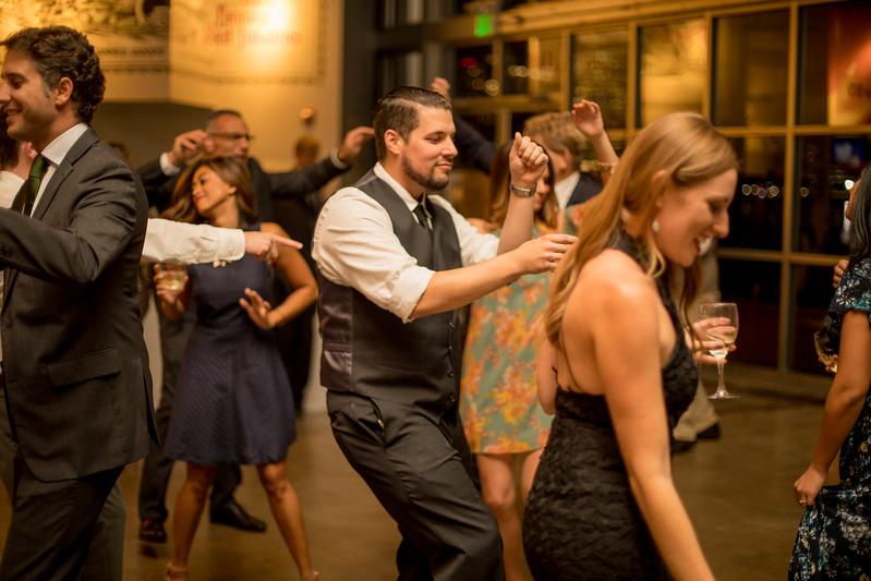groomsman dances at wedding