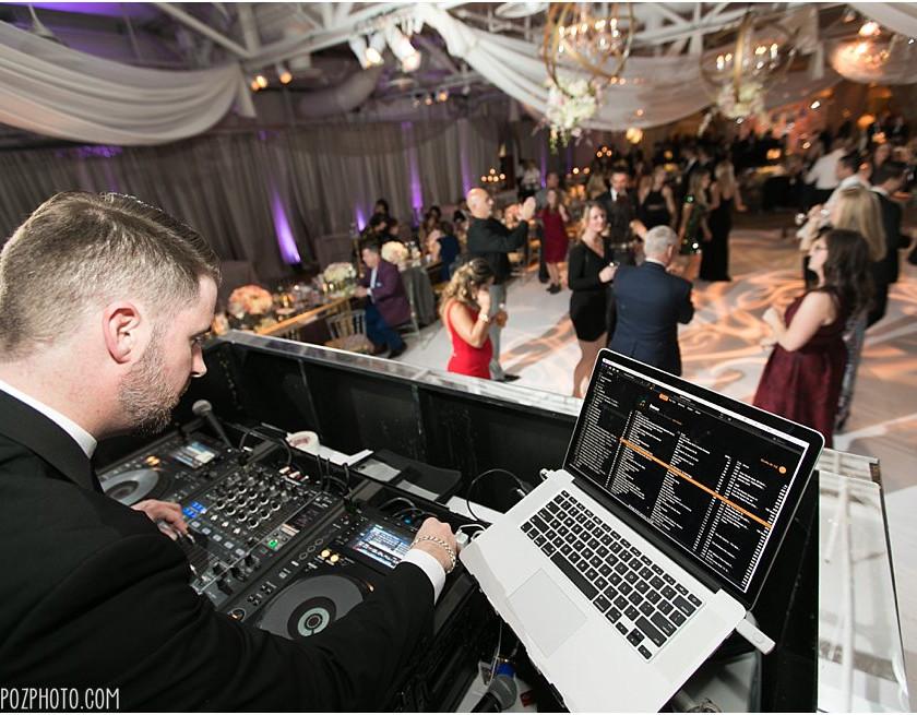dj mixing music during wedding party