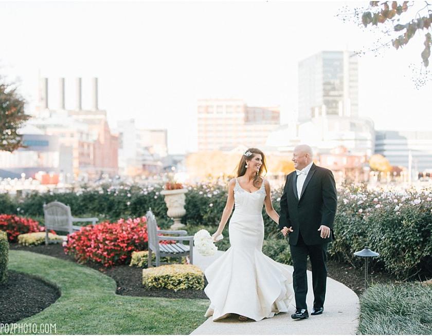 bride and groom walk along garden path