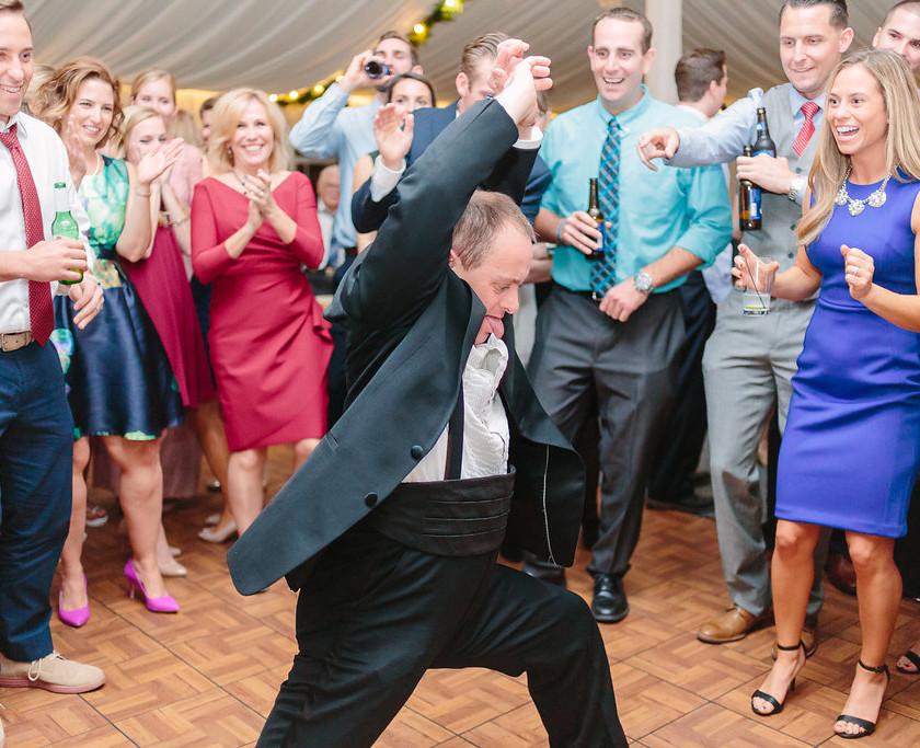 guy in tux dancing in center of dance floor