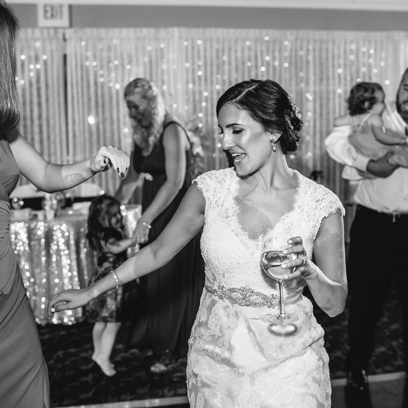 bride with wine glass dancing