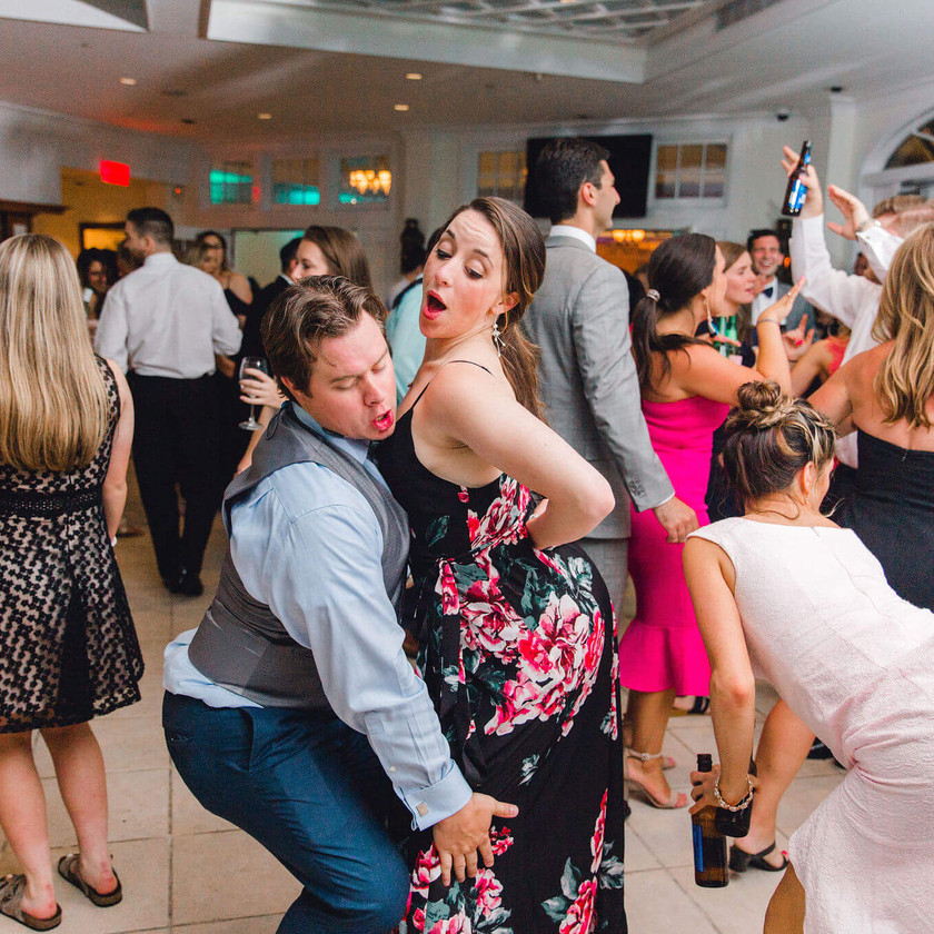 wedding guests dancing wildly at chesapeake bay beach club garden room