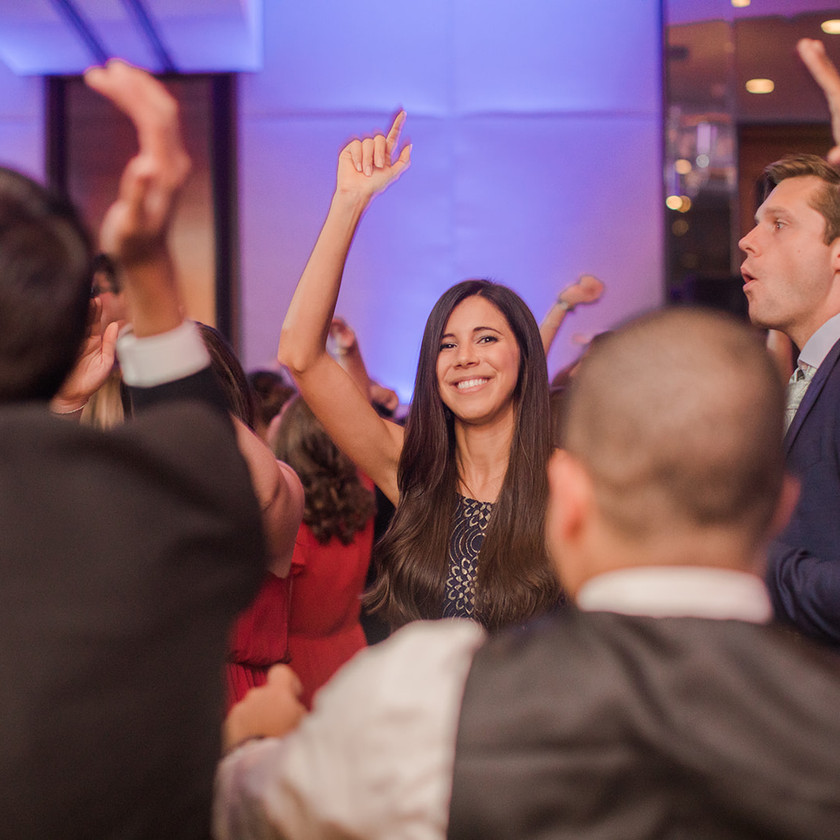 Four Seasons Baltimore wedding reception woman with hand up dancing