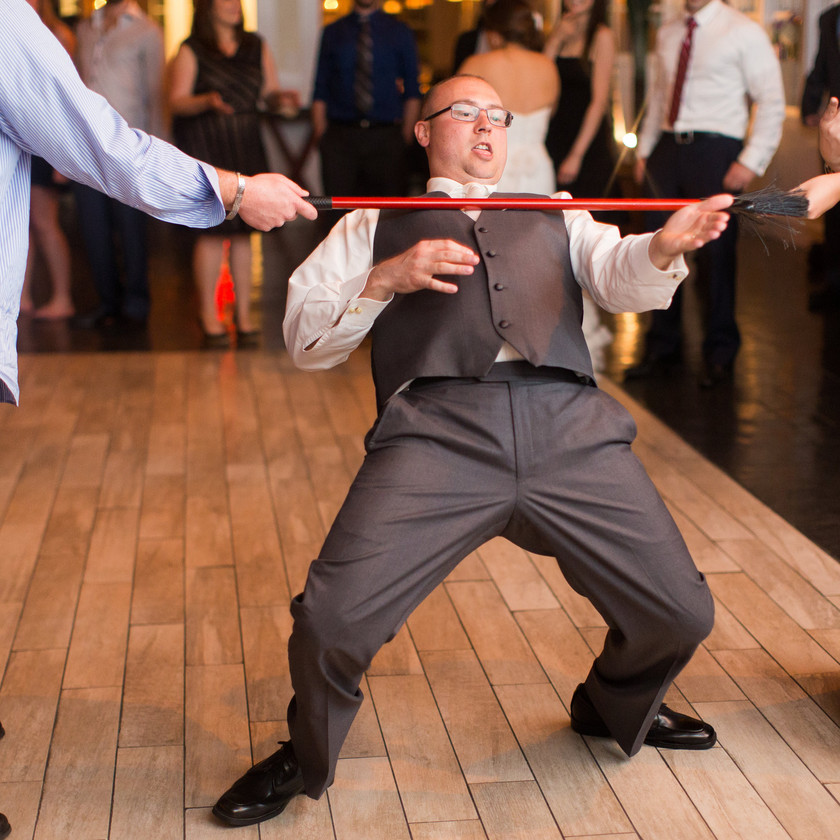 groom doing limbo