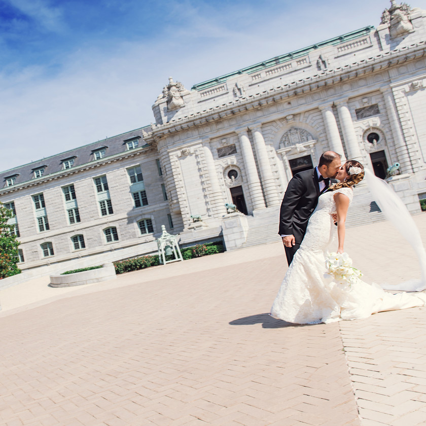 groom dips and kisses bride at naval academy