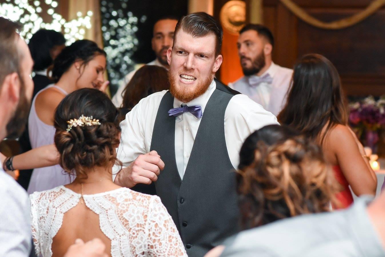 groom dances during wedding